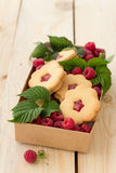 Homemade cookies with raspberry jam and fresh raspberries Royalty Free Stock Photo