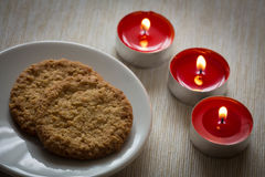 Homemade cookies surrounded by candles, hygge time. View of the Homemade cookies surrounded by candles, hygge time Stock Photography