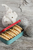 Homemade cookies in vintage box, ceramic Santa Claus and Christmas decorations on a wooden surface Stock Photography