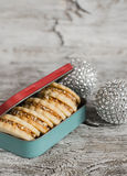 Homemade cookies in vintage box and Christmas decorations Stock Image