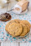 Homemade cookies from whole wheat flour with chocolate and seeds, on a platter stock photography