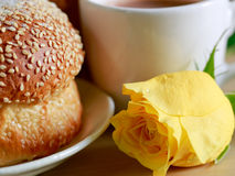 Homemade cooking made from whole wheat and grains with bread and a cup of coffee, yellow rose. Homemade cooking made from whole wheat and grains with breads and Stock Photos