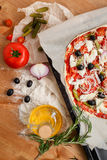 Homemade cooking. Homemade pizza cooking on natural wooden table Stock Photos