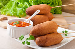 Homemade corn dogs with sauces royalty free stock photo