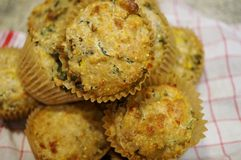 Homemade corn and kale savory muffins on a white and red cloth Royalty Free Stock Photos