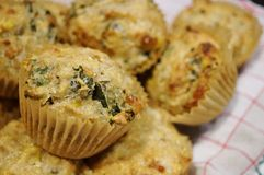 Homemade corn and kale savory muffins on a white and red cloth Stock Images