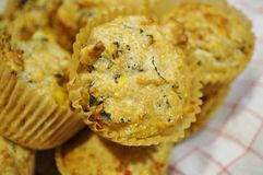 Homemade corn and kale savory muffins on a white and red cloth Stock Photo