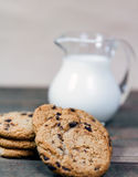 Homemade corn and oat biscuits. With chocolate and milk in glass jug Royalty Free Stock Photography
