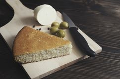 Homemade cornbread with cheese and olives on the table stock photo