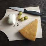 Homemade cornbread with cheese and olives on the table royalty free stock photography