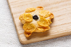 Homemade cornflakes cookies. Close up homemade cornflakes cookies heap on wooden chopping board Stock Photography