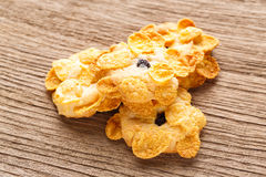 Homemade cornflakes cookies. Close up homemade cornflakes cookies heap on wooden table Royalty Free Stock Photo