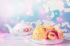 Homemade cornflakes cookies. Homemade cornflakes and raisins cookies with tea pot on old wall background. Freshly baked corn flake cereal cookies in rustic style Stock Photography