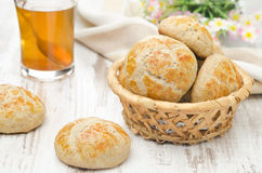 Homemade cottage cheese bread rolls in a basket and a cup of tea Stock Photos