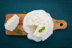 Homemade cottage cheese or curd on wooden board, rustic style Stock Photo
