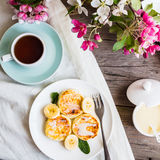 Homemade cottage cheese pancakes  with banana, condensed milk,br Stock Photos