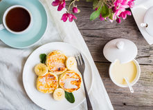 Homemade cottage cheese pancakes  with banana, condensed milk,br Stock Images
