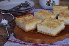 Homemade cottage cheese pie. Rustic grated cake bars on a wooden board Stock Images