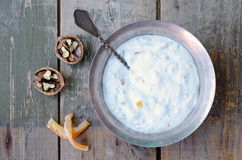 Homemade cottage cheese with walnut and sugared orange pieces in Stock Photo