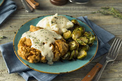 Homemade Country Fried Steak. With Gravy and Potatoes Stock Photography