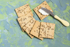 Homemade crackers with sesame, sunflower seeds and cream cheese Stock Photo