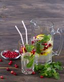 Homemade cranberry lemonade with mint. On a wooden table, rustic style Stock Photos