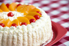 Homemade cream cake with peaches and cherries Royalty Free Stock Image
