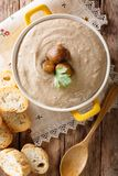 Homemade cream chestnut soup in a saucepan close-up. Vertical to. Homemade cream chestnut soup in a saucepan close-up on a table. Vertical top view from above stock photo