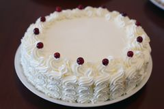 Homemade cream and lingonberry cake royalty free stock photography