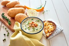 Homemade cream of potato soup with croutons, served with bread t Stock Images