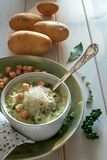 Homemade cream of potato soup in mug with croutons, parmesan che Royalty Free Stock Image