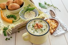 Homemade cream of potato soup with croutons and thyme, served wi. Homemade cream of potato soup in mug with croutons and thyme, served with bread toasted with royalty free stock photo