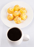 Homemade Cream Puff and Coffee II Stock Photos