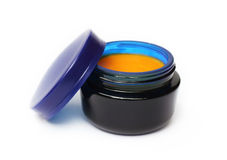 Homemade cream with sea buckthorn oil in blue glass can Stock Photography