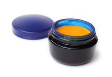 Homemade cream with sea buckthorn oil in blue glass can Royalty Free Stock Photo