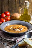 Homemade cream of tomato soup. Served in bowl on rustic ooden background, Selective Focus royalty free stock images