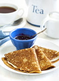 Homemade crepes folded in triangles with black currant jam. stock images
