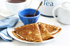 Homemade crepes folded in triangles with black currant jam. stock image