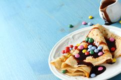 Homemade crepes with multicolored dragee Stock Image