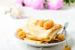 Homemade  crepes served with fresh yelllow raspberries Royalty Free Stock Images
