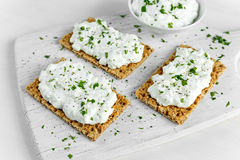 Homemade Crispbread toast with Cottage Cheese and parsley on white wooden board. Homemade Crispbread toast with Cottage Cheese and parsley on white wooden board Royalty Free Stock Image