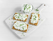Homemade Crispbread toast with Cottage Cheese and parsley on white wooden board. Stock Photography