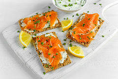 Homemade Crispbread toast with Smoked Salmon, Melted Cheese and cress salad. on white wooden board Stock Images