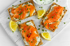 Homemade Crispbread toast with Smoked Salmon, Melted Cheese and cress salad. on white wooden board Royalty Free Stock Photos