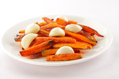 Homemade crispy baked carrots with garlic. Royalty Free Stock Image