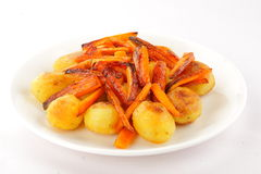 Homemade crispy Baked carrots and potatoes. Royalty Free Stock Photography