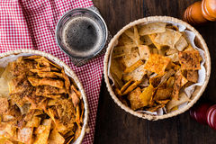 Homemade Crispy Chips / Snacks in a wicker bowl with beverage stock images