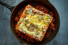 Homemade Crispy lasagna in iron pan with minced beef bolognese sauce, parmesan cheese Stock Photography