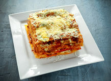 Homemade Crispy lasagna in iron pan with minced beef bolognese sauce, parmesan cheese Royalty Free Stock Image