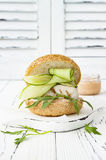 Homemade crispy spring fish burger with spicy chilli mayo on white rustic wooden board over light background. Copy space. Homemade crispy spring fish burger Royalty Free Stock Photo